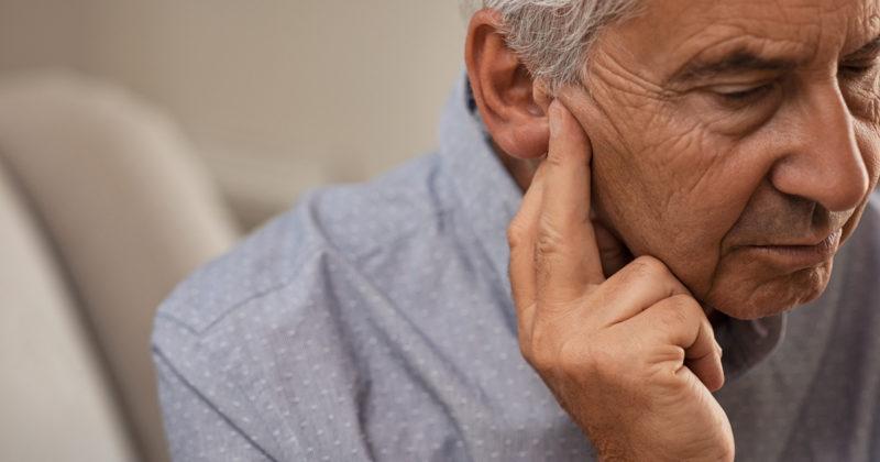 Senior man with hearing loss